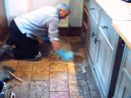 Tile Doctor in Action cleaning a Kitchen floor