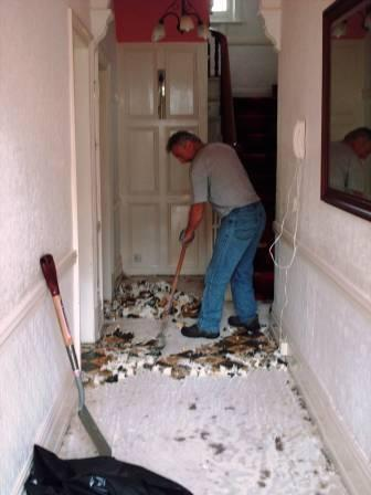 Tile Doctor in Action Striping a Victorian Tile hallway floor
